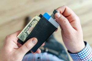 person-holding-black-card-holder